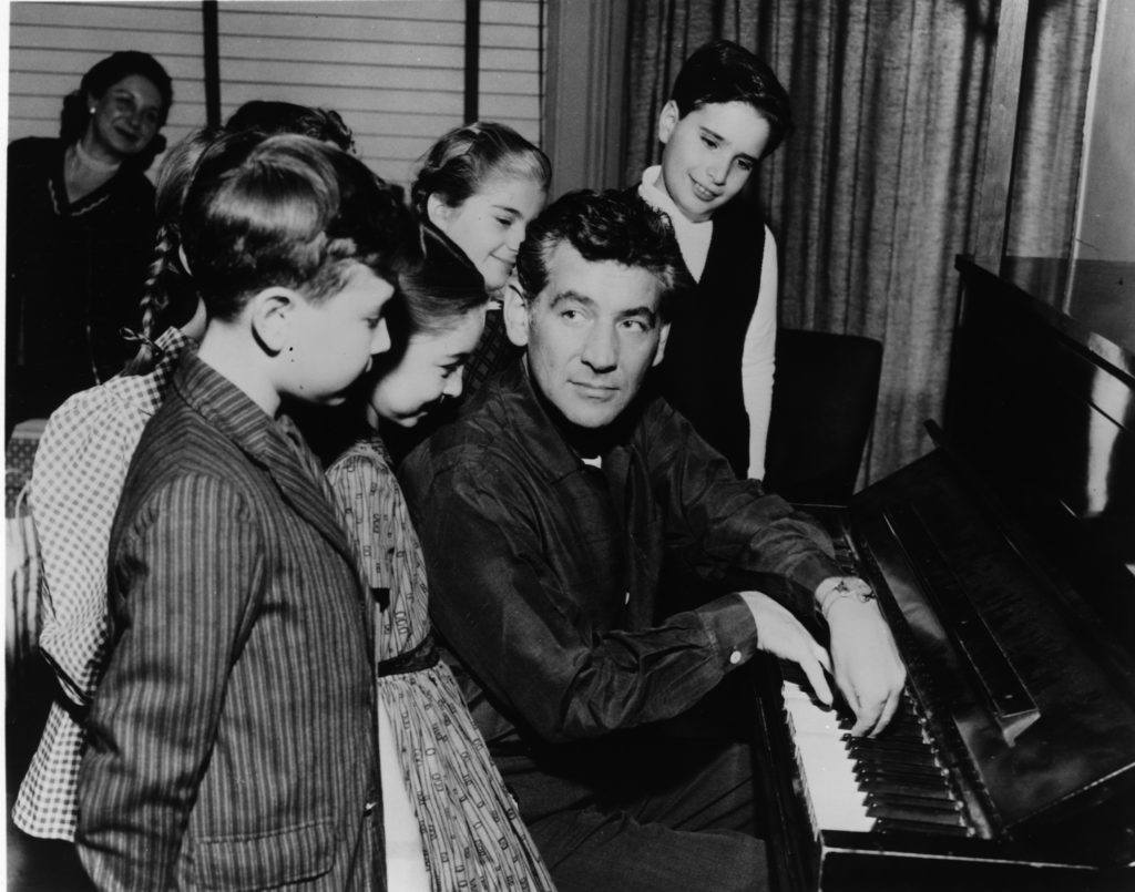 Bernstein with children courtesy of New York Philharmonic Leon Levy Digital Archives