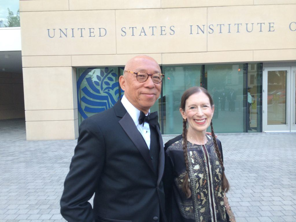 Awardees Ping Chong and Meredith Monk, both of whom appear on UMS's 2016-17 season, outside the United States Institute of Peace, site of the Gala Dinner held on the eve of the White House ceremony.